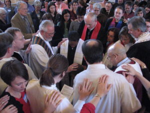 Laying on of hands. The moment of ordination.